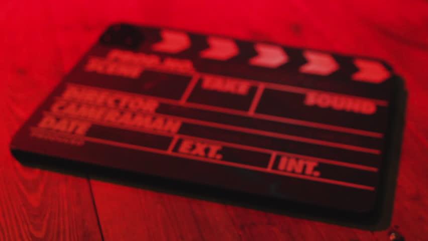 Black clapperboard movies symbol by an film slate handheld
