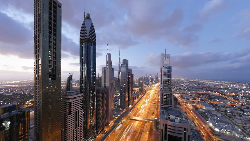 DUBAI, UNITED ARAB EMIRATES - CIRCA MAY 2011: Sheikh Zayed Rd, showing the new MTR track and station system and the Burj Khalifa.