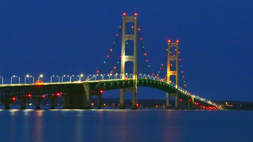 The lights of scenic, Majestic Mackinac Bridge sparkle in deep blue predawn twilight, Upper Peninsula of Michigan.