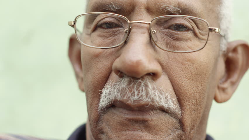 Senior people and feelings, portrait of sad old african american man with glasses and mustache