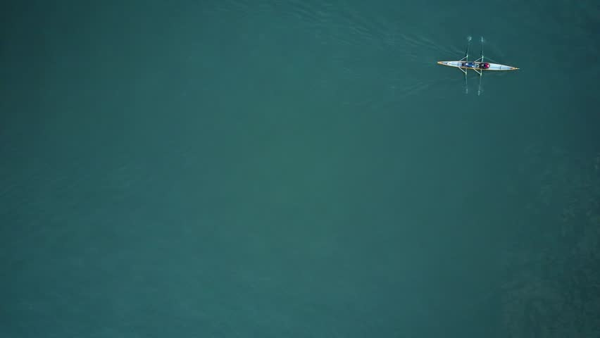 Paddle in the blue lake of Zurich. One single boat alone on the view of a drone #25991651