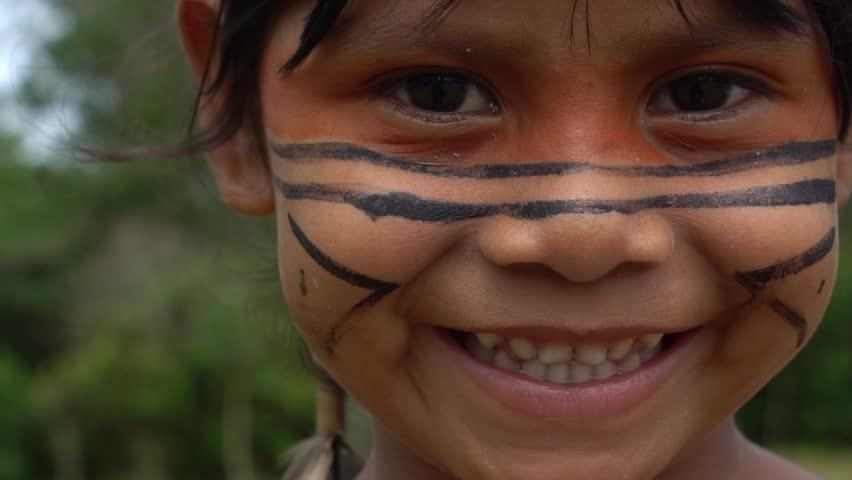 Closeup face of Native Brazilian children at an indigenous tribe in the Amazon