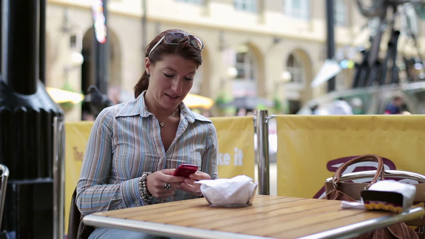Young woman using cellphone in cafe HD - HD stock footage clip