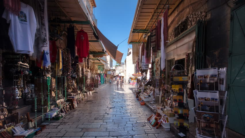 The colorful souk near Holy Sepulchre in the old city of Jerusalem Israel timelapse hyperlapse. Crowd of people passing by on this makret