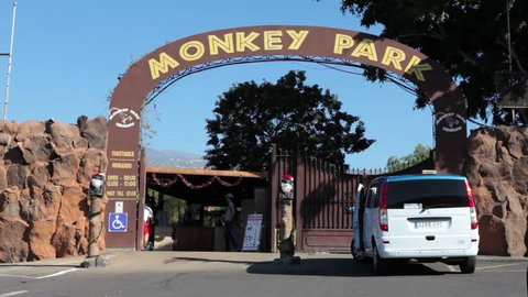 LOS CRISTIANOS, TENERIFE, SPAIN - CIRCA JAN, 2016: Taxi van stands near entrance of small zoo the Monkey Park. The Monkey Park is an international breeding centre for endangered species of primates