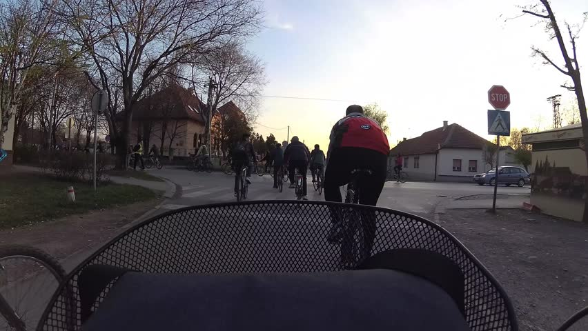 cyclists ride through the streets of the city
