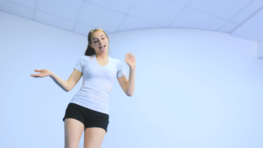 young girl fooling and laughing on the bosu simulator in clinic