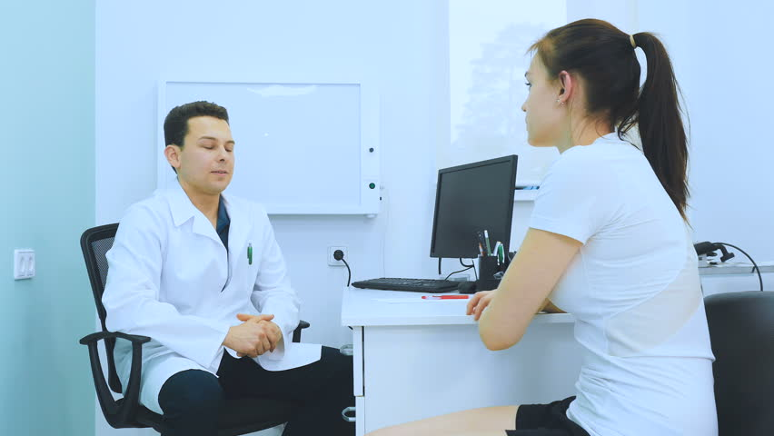 Young girl talking about her problems with hand to doctor | Shutterstock HD Video #26034641