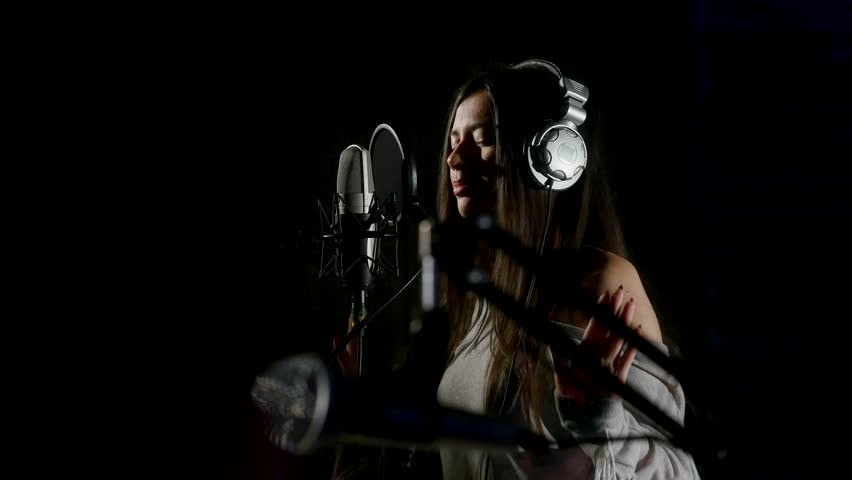 Beautiful girl sings in a recording studio. #26070821