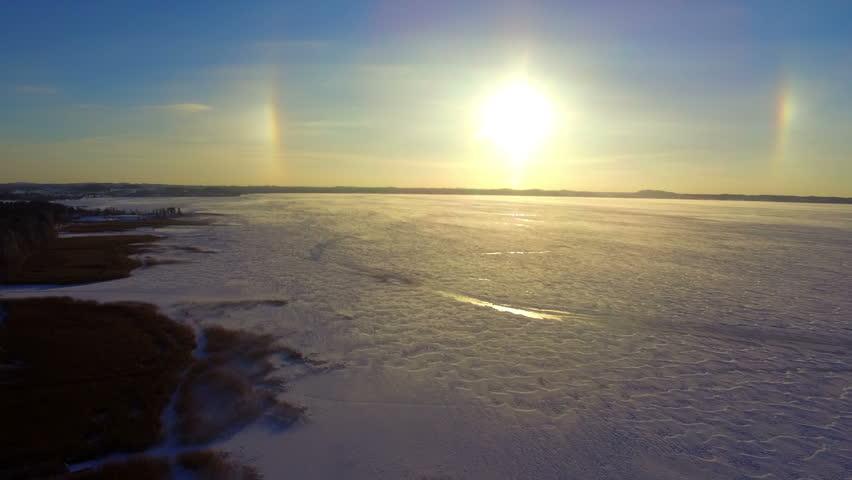 Drone flight over the snowy frozen lake | Shutterstock HD Video #26072861