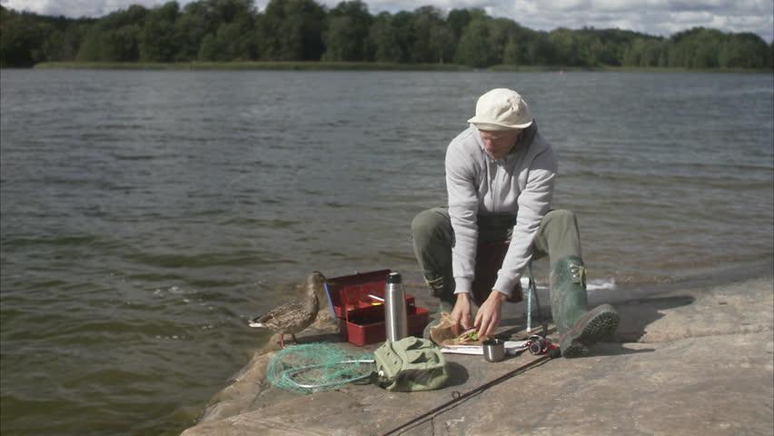 A man having a coffee break during a fishing tour