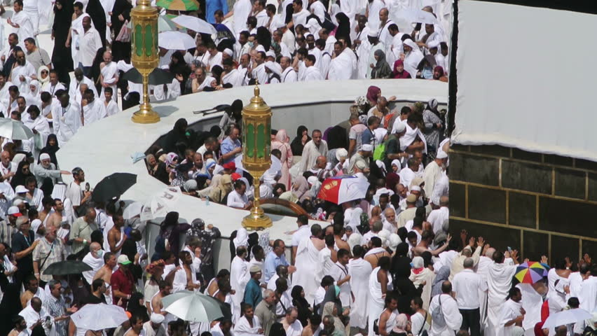 Mecca, Saudi Arabia - September 10, 2016: Muslim pilgrims put on their white ihrams praying in hijr ismail next to the holy Kaaba during Hajj in Saudi Arabia