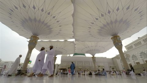 Medina, Saudi Arabia - September 5, 2016: Time Lapse video in Medina Saudi Arabia. Muslim believers walking, waiting and praying outside the al-Masjid an-Nabawi, prophet Muhammad's Mosque, during hajj
