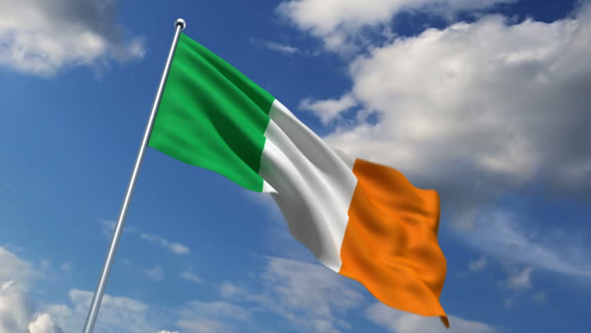 Irish flag waving against time-lapse clouds background