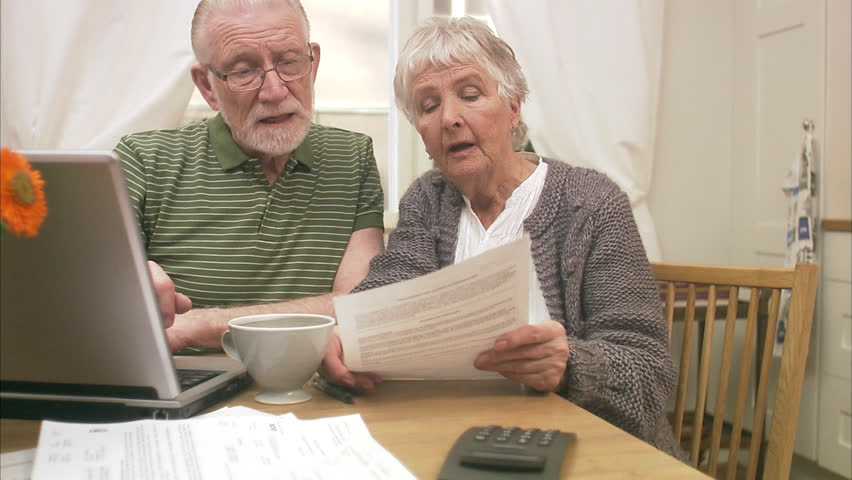An elderly couple using a laptop at home | Shutterstock HD Video #2614961