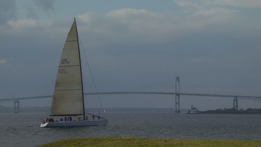 NEWPORT, RHODE ISLAND - CIRCA AUGUST 2007: Large sailboat tacking on Narragansett Bay with span of Newport Bridge in distance