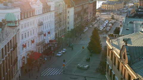 City street and buildings at sunset. Pedestrians walking, Helsingborg, Sweden