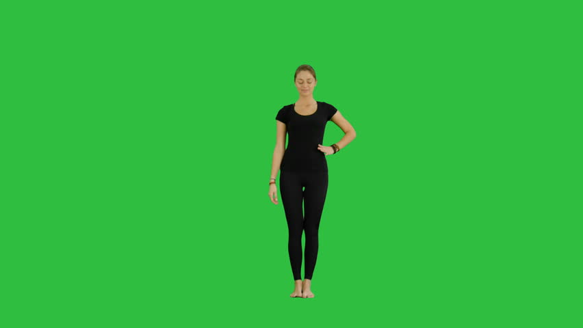 Athletic girl standing in yoga asana utthita hasta Padangustasana, extended hand to big toe yoga pose stretched hand grasps big toe on a Green Screen, Chroma Key