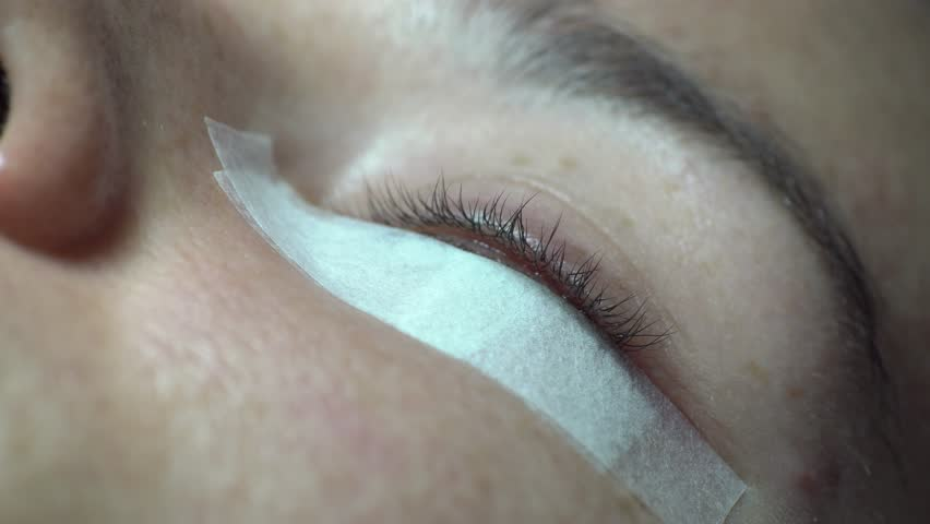 Close-up of master lash maker remove oil, preparing for eyelash extension