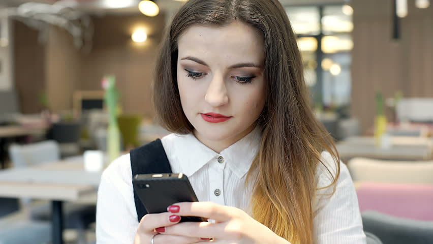 Absorbed businesswoman texting messages on smartphone in the cafe  | Shutterstock HD Video #26190914