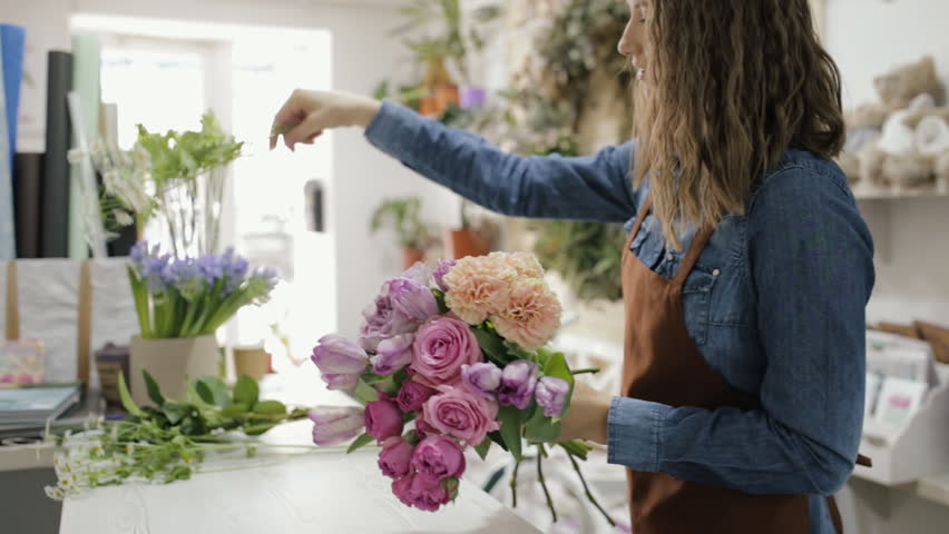 Florist woman make a bouquet of beautiful flowers