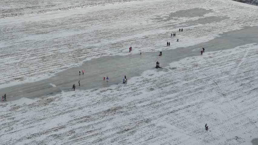 People skating on outdoor Ice  in winter sunny day, aerial view   Shutterstock HD Video #26259731