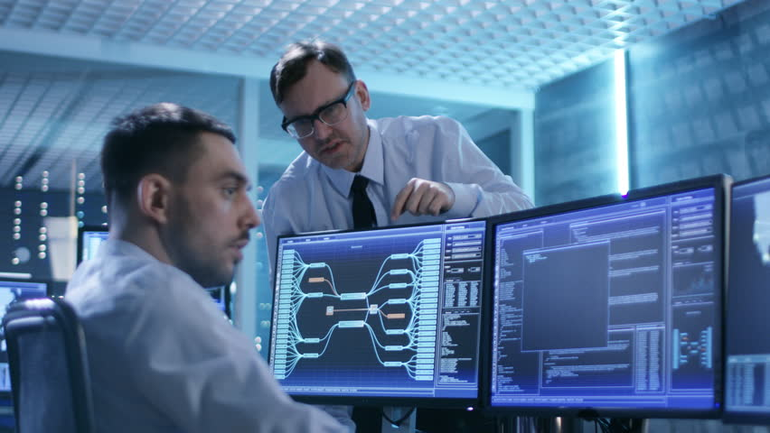 In the System Control Center Technical Support Team Gives Instructions with the Help of the Headsets. Shot on RED EPIC-W 8K Helium Cinema Camera. | Shutterstock HD Video #26262971