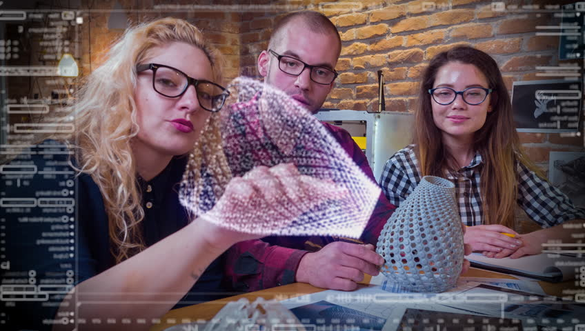 Young Creative Team Working On Futuristic Hud Touch Screen Developing 3D Printing Project Future Technology Team Work Concept | Shutterstock HD Video #26264081
