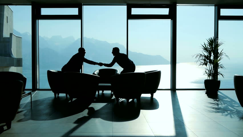 sales agent meeting with customer in modern lobby hall talking about financial agreement. business partners having a conversation