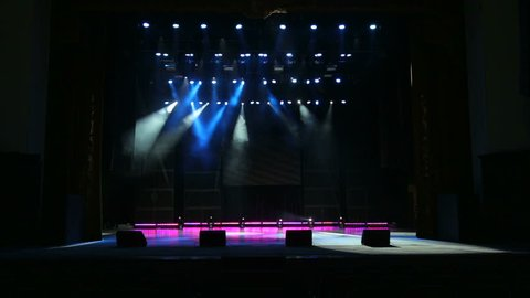 Multicolored spotlights at a concert. Empty stage before a concert.