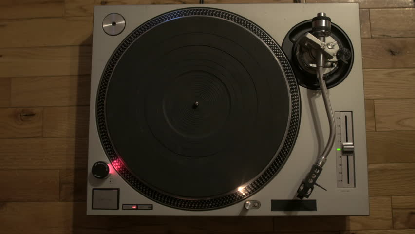 Putting a Record on a Turntable.