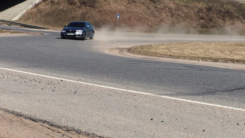MINSK, BELARUS - APRIL 2, 2017: 2017 BMW 520d (G30) drives hard and takes corner fast on a road. BMW 5 Series is dynamic and enjoyable to drive, in 7th generation it is an ultimate driving machine.