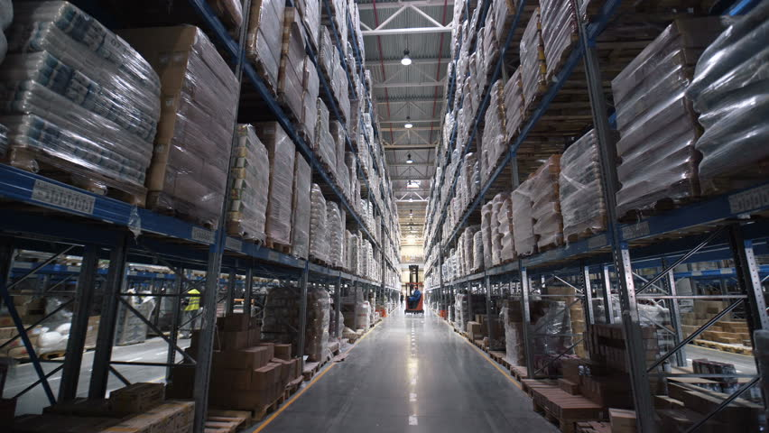 Big factory warehouse. store Aisles. Camera travels inside a large store. Warehouse shipping. Large warehouse logistics terminal. Moving camera | Shutterstock HD Video #26284271