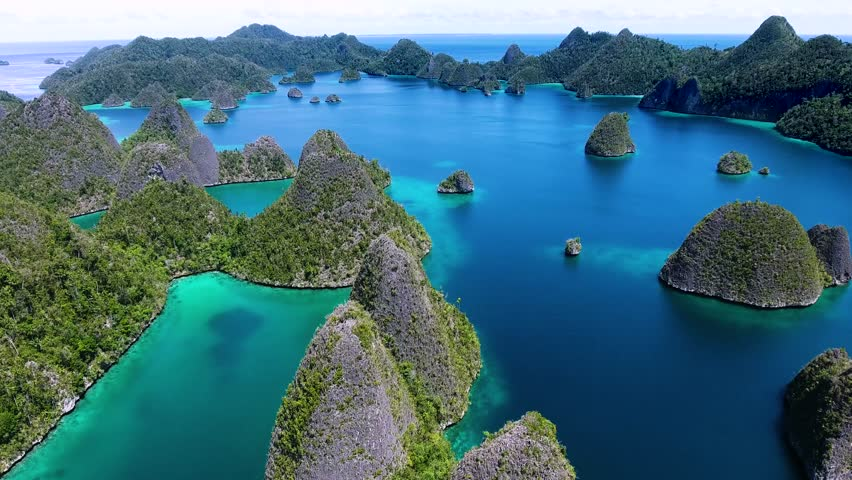 The islands of Wayag - is the most scenic area of Raja Ampat, West Papua, Indonesia. Is dominated by hundreds of limestone islands and surrounded by a lagoon (green to turquoise). March 31, 2017
