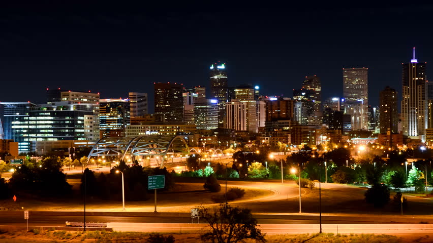 denver zoom in on night skyline and city traffic timelapse 1080p