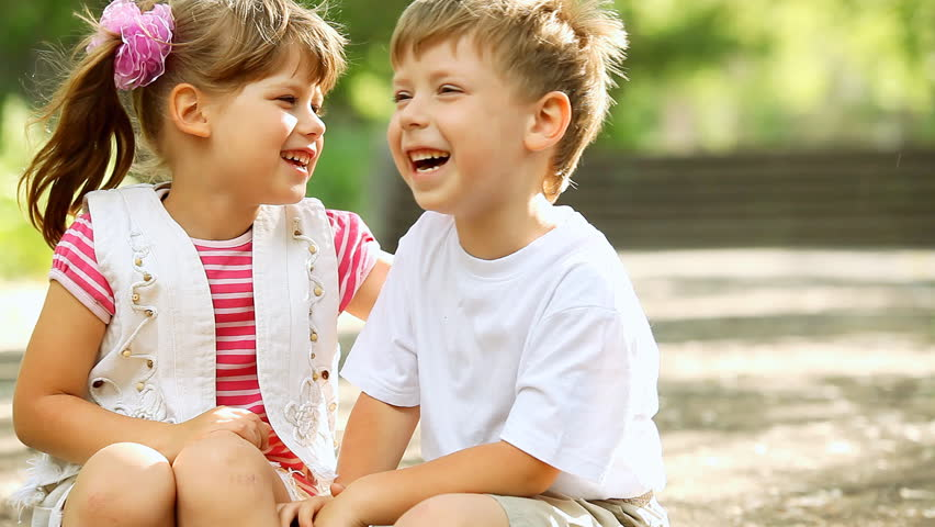 Two child funning in park, outdoors