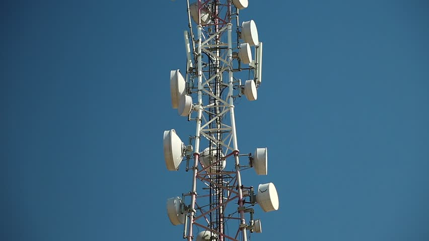 Cell phone telecommunication tower. Communication tower antenna on blue background. Antennas of mobile phone communication, television, internet, radio, on blue sky background   Shutterstock HD Video #26332721