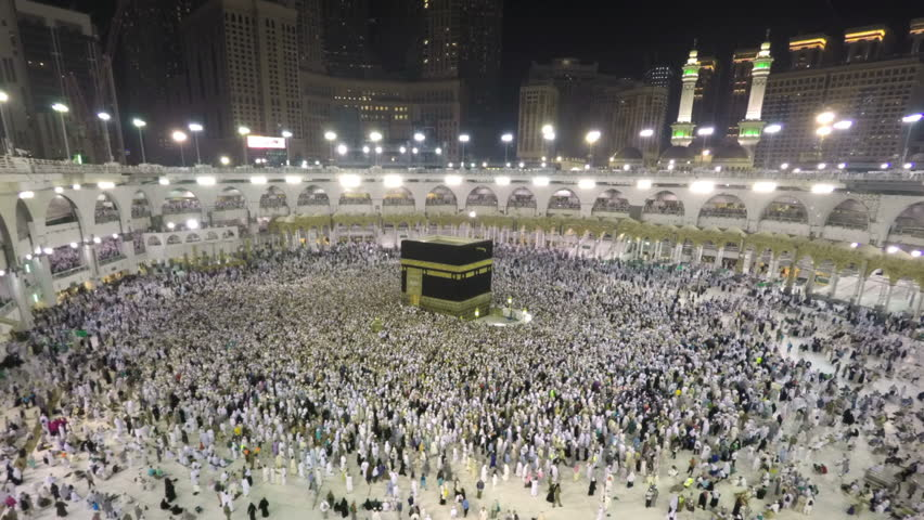 Mecca, Saudi Arabia - September 15, 2016: Time lapse video of Muslim pilgrims circling around the holy Kaaba at night during Hajj inside al Masjid al Haram in Mecca, Saudi Arabia. Camera zoomin in.