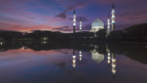 Sunrise Time Lapse with reflection at a Mosque. Sultan Sallehuddin Abdul Aziz Shah Mosque, Shah Alam, Malaysia, 4K.