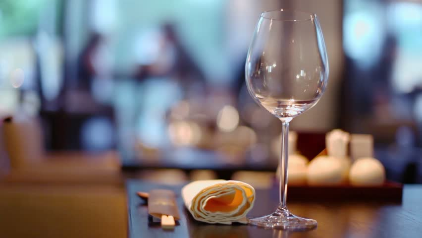 Several clients sit in restaurant, glass with napkin and chopsticks at table, focus changes