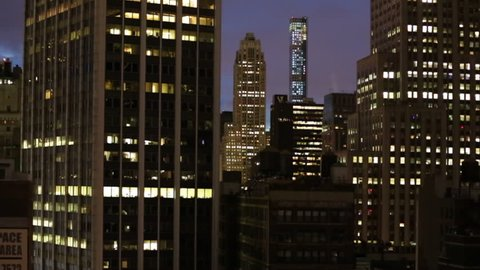 A night view of several generic skyscrapers on the island of Manhattan, a borough in New York City, USA.