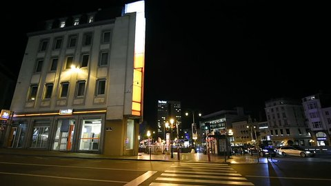 BRUSSELS, BELGIUM - CIRCA 2016: Night view over Avenue de la Toison d'Or Brussels with The Hotel building in the background, cars, banks and typical Brussels architecture