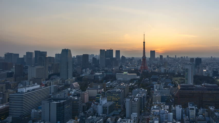 4k time lapse of night to day sunrise scene at Tokyo city skyline with Tokyo Tower. Pan right   Shutterstock HD Video #26419391