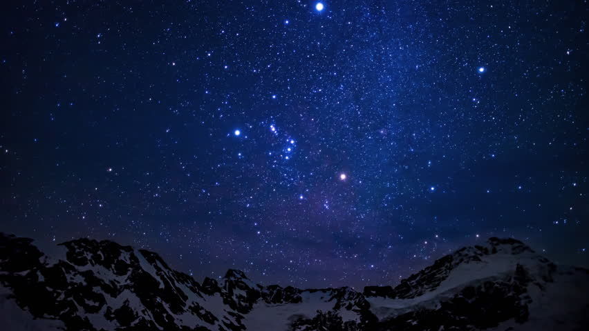 Time lapse of an amazing starry sky in motion above the summit of snowy mountains in Aoraki mount cook national park in the south island of New Zealand