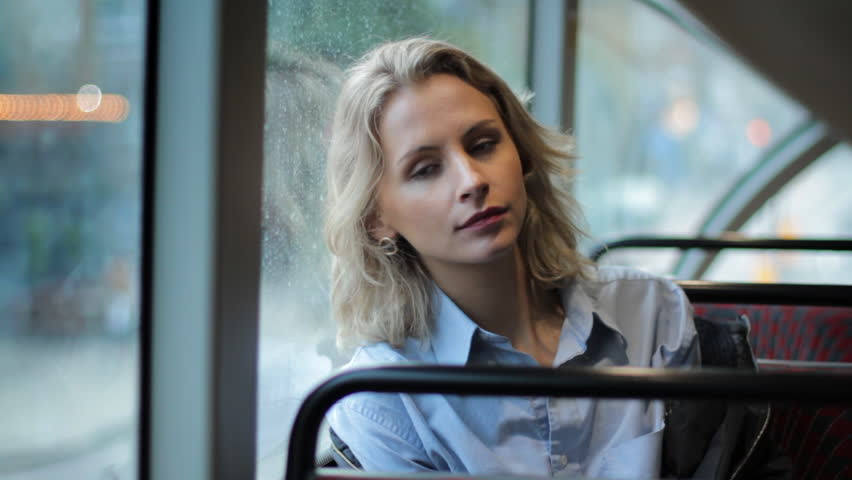Young blonde girl looking out the window on the bus | Shutterstock HD Video #26477453