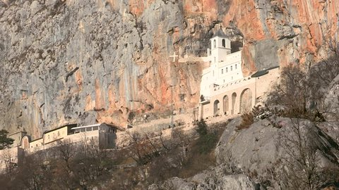 Ostrog Monastery in Montenegro. The Monastery of Ostrog is a monastery of the Serbian Orthodox Church sitatued against an almost vertical background, high up in the large rock of Ostroška Greda.