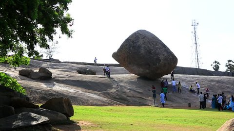 TAMIL NADU, INDIA - JUNE 2012: Locked-on shot of a boulder, Krishnas Butter Ball, Mahabalipuram, Kancheepuram District, Tamil Nadu, India