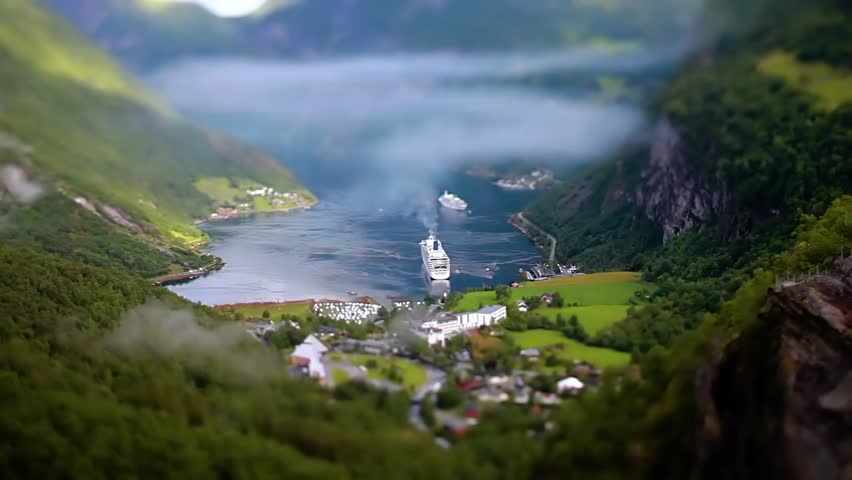 Tilt shift lens - Geiranger fjord, Beautiful Nature Norway. It is a 15-kilometre (9.3 mi) long branch off of the Sunnylvsfjorden, which is a branch off of the Storfjorden (Great Fjord). | Shutterstock HD Video #26497913