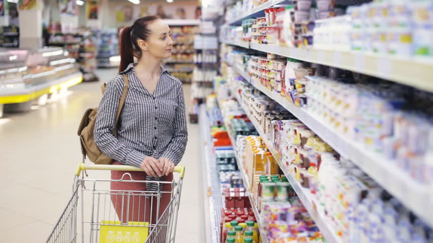 Young pretty woman shopping in grocery supermarket | Shutterstock HD Video #26522993