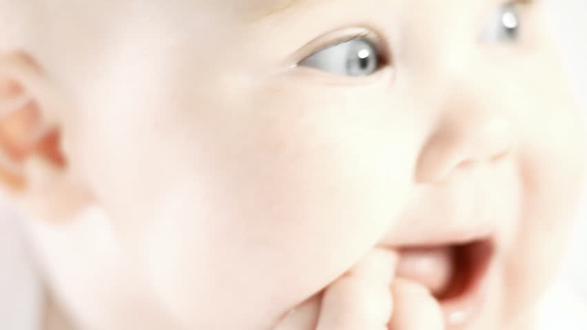 Smiling baby on the light background | Shutterstock HD Video #2659835